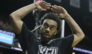 VCU guard Jonathan Williams (10) riles up the crowd after drawing a foul in the second half of an NCAA college basketball game against Davidson in the semifinals of the Atlantic 10 Conference tournament in New York, Saturday, March 14, 2015. VCU won, 93-73. (AP Photo/John Minchillo)