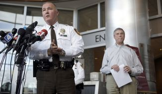 St. Louis County Police Chief Jon Belmar, left, speaks during a news conference as St. Louis County Prosecutor Robert McCulloch listens Sunday, March 15, 2015, in Clayton, Mo. McCulloch said 20-year-old Jeffrey Williams has been charged with two counts of first-degree assault in the shooting of two St. Louis-area officers. (AP Photo/Jeff Roberson)