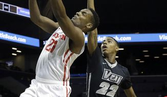 Dayton forward Dyshawn Pierre (21) goes to the basket past VCU forward Terry Larrier (22) during the first half of an NCAA college basketball game in the final round of the Atlantic 10 Conference tournament in New York, Sunday, March 15, 2015. (AP Photo/Mary Altaffer)