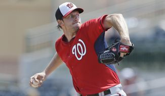 Washington Nationals starting pitcher Max Scherzer throws during the first inning of a spring training exhibition baseball game against the Houston Astros in Kissimmee, Fla., Sunday, March 15, 2015. (AP Photo/Carlos Osorio)