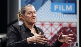 """United Therapeutics CEO Martine Rothblatt gives a keynote on """"AI, Immortality and the Future of Selves"""" during the SXSW Interactive Festival on Saturday, March 14, 2015 in Austin, Texas.  (AP Photo/Jack Plunkett)"""