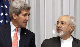 U.S. Secretary of State John Kerry, left, listens to Iran's Foreign Minister Mohammad Javad Zarif, right, before resuming talks over Iran's nuclear program in Lausanne, Switzerland, Monday, March 16, 2015. (AP Photo/Brian Snyder, Pool)