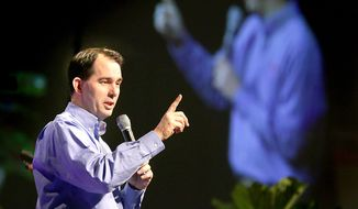 Wisconsin Gov. Scott Walker speaks at the Governor's Conference on Tourism at the La Crosse Center Monday, March 16, 2015, in La Crosse, Wis. (AP Photo/The La Crosse Tribune, Erik Daily) ** FILE **