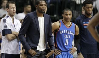 Oklahoma City Thunder forward Kevin Durant, left, and Oklahoma City Thunder guard Russell Westbrook (0) watch the final seconds of an NBA basketball game against the Dallas Mavericks, Monday, March 16, 2015, in Dallas. The Mavericks won 119-115. (AP Photo/The Dallas Morning News, Vernon Bryant) MANDATORY CREDIT; MAGS OUT; TV OUT; INTERNET USE BY AP MEMBERS ONLY; NO SALES