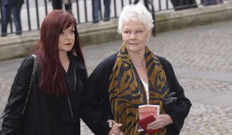 In this March 2015 photo, Judi Dench and daughter Finty Williams arrive at Westminster Abbey in London for the memorial service of film legend Richard Attenborough. In June 2016, Ms. Dench told an English magazine that she got a tattoo for her 81st birthday, courtesy of her daughter. (AP Photo/PA, Stefan Rousseau) *FILE*