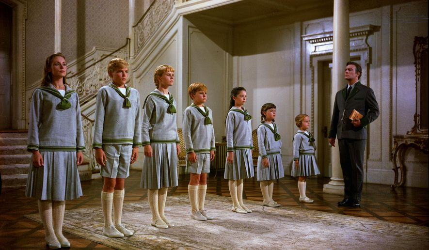"""This photo provided by Twentieth Century Fox Home Entertainment shows, from left, Chairmian Carr, as Liesl, Nicholas Hammond, as Friedrich, Heather Menzies, as Louisa, Duane Chase, as Kurt, Angela Cartwright, as Brigitta, Debbie Turner, as Marta, Kym Karath, as Gretl, and Christopher Plummer, as Captain Von Trapp, in a scene from the film, """"The Sound of Music."""" The 1965 Oscar-winning film adaptation of the Rodgers & Hammerstein musical """"The Sound of Music"""" is celebrating its 50th birthday in 2015. To honor the milestone, 20th Century Fox is releasing a five-disc Blu-ray/DVD/Digital HD collector's edition, the soundtrack is being re-released, the film will be screened at the TCM Classic Film Festival in Hollywood later this month and to over 500 movie theaters in April. (AP Photo/Twentieth Century Fox Home Entertainment)"""