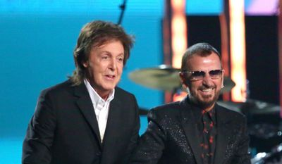 In this Jan. 26, 2014, file photo, Paul McCartney, left, and Ringo Starr appear at the 56th annual Grammy Awards in Los Angeles. McCartney will induct his former Beatle mate, Ringo Starr, into the Rock and Roll Hall of Fame next month. The 30th annual induction ceremony is scheduled for Cleveland's Public Hall on April 18. (Photo by Matt Sayles/Invision/AP, File)