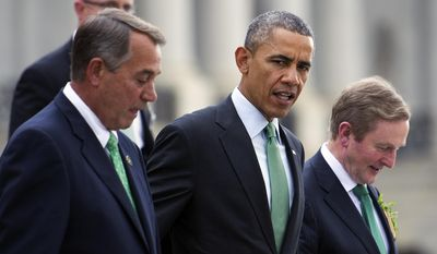 President Barack Obama walks with House Speaker John Boehner of Ohio, left, and Irish Prime Minister Enda Kenny as they depart Capitol in Washington, Tuesday, March 17, 2015, following a Friends of Ireland luncheon. (AP Photo/Cliff Owen)
