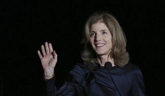 U.S. Ambassador to Japan Caroline Kennedy waves before she delivers opening remarks during JFK International Symposium at Waseda University in Tokyo Wednesday, March 18, 2015. Japanese police are investigating phone calls threatening to kill U.S. Ambassador Kennedy. (AP Photo/Eugene Hoshiko)