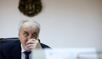 Serbia's war crimes prosecutor Vladimir Vukcevic gestures during an interview with The Associated Press in Belgrade, Serbia, Wednesday, March 18, 2015. Prosecutors on Wednesday made Serbia's first arrests of people suspected of carrying out killings in the Srebrenica massacre. It is a milestone in healing the wounds of Europe's worst civilian slaughter since World War II. (AP Photo/Darko Vojinovic)