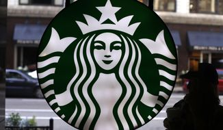 In this Saturday, May 31, 2014, file photo, the Starbucks logo is seen at one of the company's coffee shops in downtown Chicago. (AP Photo/Gene J. Puskar, File)