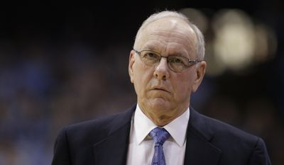 In this Jan. 26, 2015, file photo, Syracuse coach Jim Boeheim walks along the sidelines during the first half of an NCAA college basketball game against North Carolina in Chapel Hill, N.C. (AP Photo/Gerry Broome, File)