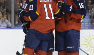 Florida Panthers right wing Jaromir Jagr (68) is congratulated by center Jonathan Huberdeau (11) and center Aleksander Barkov (16) after scoring a goal during the second period of an NHL hockey game against the Detroit Red Wings, Thursday, March 19, 2015, in Sunrise, Fla. (AP Photo/Lynne Sladky)