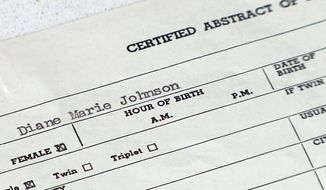 Off-the-books adoptions: This June 16, 2014, photo shows Diane Warner's birth certificate.  Diane Warner of Grand Rapids, Michigan, is one of the 200 newborns in the 1950s and 60s that were relocated in off-the-books adoptions through Dr. Thomas Hicks' McCaysville clinic in far northern Georgia. (AP Photo/Alex Sanz)