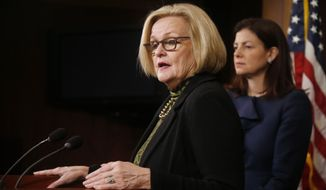 Sen. Claire McCaskill, D-Mo., left, and Sen. Kelly Ayotte, R-N.H., participate in a news conference on Capitol Hill in Washington, Thursday, March 6, 2014, following a Senate vote on military sexual assaults. (AP Photo/Charles Dharapak) **FILE**