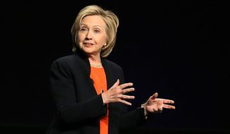 Hillary Clinton is the keynote speaker at the American Camp Association, New York and New Jersey's Tri State CAMP Conference at the Atlantic City Convention Center, in Atlantic City, NJ, Thursday March 19, 2015. (AP Photo/The Press of Atlantic City, Ben Fogletto)