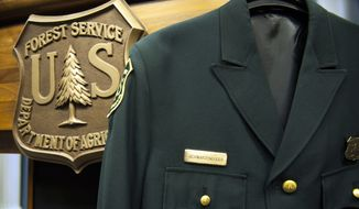 Former California Gov. Arnold Schwarzenegger's U.S. Forest Ranger jacket hangs on the podium before an Oct. 30, 2013 ceremony at the Agriculture Department in Washington where he was named the U.S. Forest Service's  third honorary Forest Ranger for his leadership on climate change. (Associated Press)