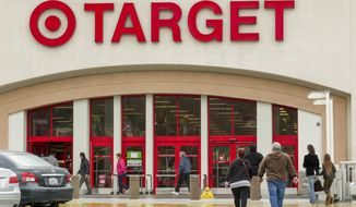 Shoppers arrive at a Target store in Los Angeles on Dec. 19, 2013. (Associated Press) **FILE**
