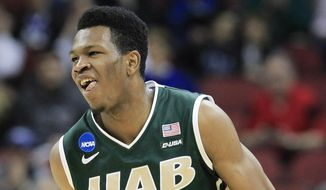 UAB forward William Lee smiles after scoring against Iowa State during the first half of an NCAA tournament second round college basketball game in Louisville, Ky., Thursday, March 19, 2015. (AP Photo/David Stephenson)
