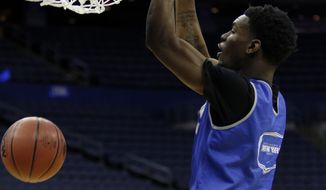 Buffalo forward Xavier Ford dunks during practice at the NCAA college basketball tournament in Columbus, Ohio, Thursday, March 19, 2015. Buffalo plays West Virginia in the second round on Friday. (AP Photo/Paul Vernon)