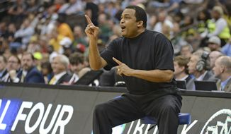 Georgia State head coach Ron Hunter directs his players on the court during the first half of an NCAA tournament second round college basketball game against Baylor, Thursday, March 19, 2015, in Jacksonville, Fla.  (AP Photo/Rick Wilson)