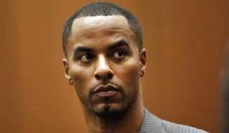 Former NFL safety Darren Sharper appears in Los Angeles Superior Court in Los Angeles in this Feb. 20, 2014, file photo Rape charges have been filed on Friday, March 20, 2015, in Las Vegas against the former NFL safety, who already faces sexual assault charges in Los Angeles, New Orleans and the Phoenix area. (AP Photo/Los Angeles Times, Bob Chamberlin, Pool)