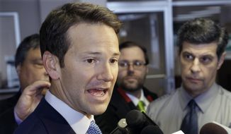 Then-Rep. Aaron Schock, R-Ill. speaks to reporters in Peoria Ill., in this Feb. 6, 2015, file photo. (AP Photo/Seth Perlman, File)