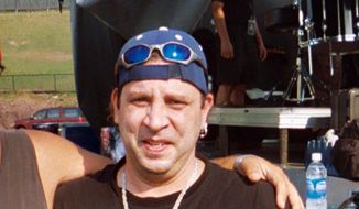 This Aug. 21, 2005, photo shows Twisted Sister drummer A.J. Pero before a concert in Little Falls, N.J. Pero died of an apparent heart attack on Friday, March 20, 2015, while touring with Adrenaline Mob, a group with which he played in between engagements with Twisted Sister. He was 55. (AP Photo/Wayne Parry)