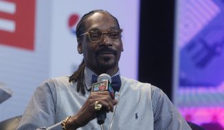 "Snoop Dogg takes part in the ""Keynote Conversation with Snoop Dogg"" during the SXSW Music Festival on Friday, March 20, 2015 in Austin, Texas. (Photo by Jack Plunkett/Invision/AP)"