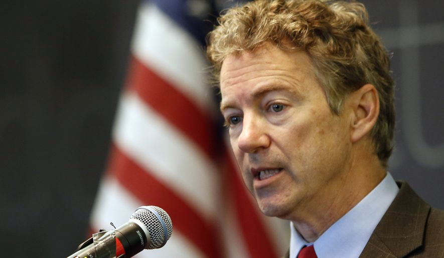 Sen., Rand Paul, R-Ky. speaks to employees during a visit to Dyn, an internet performance company Friday, March 20, 2015, in Manchester, N.H. (AP Photo/Jim Cole)