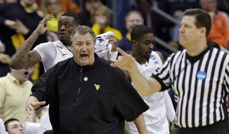 West Virginia head coach Bob Huggins argues a call in the first half of an NCAA tournament college basketball game against Buffalo in the Round of 64 in Columbus, Ohio Friday, March 20, 2015. (AP Photo/Tony Dejak)