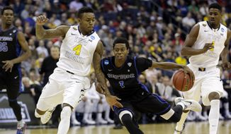 Buffalo's Lamonte Bearden (1) tries to get past West Virginia's Daxter Miles Jr. (4) in the second half of an NCAA tournament college basketball game in the Round of 64 in Columbus, Ohio Friday, March 20, 2015. (AP Photo/Tony Dejak)