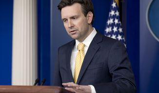 White House press secretary Josh Earnest speaks during his daily news briefing at the White House in Washington, Friday, March 20, 2015, answering questions from IS to Israel. (AP Photo/Jacquelyn Martin)