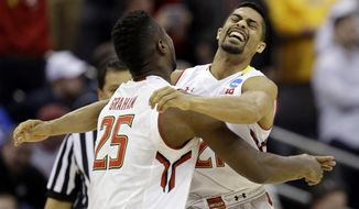 Maryland's Jonathan Graham (25) and Varun Ram celebrate after a 65-62 win over Valparaiso in an NCAA tournament college basketball game in the Round of 64 in Columbus, Ohio, Friday, March 20, 2015. (AP Photo/Tony Dejak)