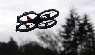 A radio-controlled drone appears in flight during an International Drone Day event at an elementary school in Roseburg, Ore., in this March 14, 2015, file photo. (AP Photos/The News-Review, Michael Sullivan, File)