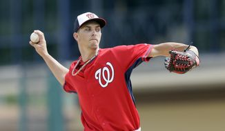 Washington Nationals starting pitcher A.J. Cole throws during the second inning of a spring training exhibition baseball game against the Detroit Tigers in Lakeland, Fla., Sunday, March 22, 2015. (AP Photo/Carlos Osorio)