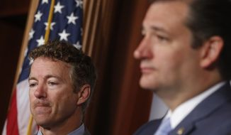 Sen. Rand Paul, R-Ky., and Sen. Ted Cruz, R-Texas listen as Sen. Kirsten Gillibrand, D-N.Y., speaks to reporters during a news conference about a bill regarding military sexual assault cases on Capitol Hill in Washington, Tuesday, July 16, 2013. (AP Photo/Charles Dharapak)