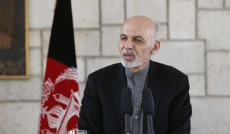 Afghan President Ashraf Ghani addresses a new conference with U.S. Defense Secretary Ashton Carter at the Presidential Palace in Kabul, Afghanistan, in this Feb. 21, 2015, file photo. (AP Photo/Jonathan Ernst, Pool) ** FILE **