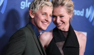 Ellen DeGeneres, left, and Portia de Rossi arrive at the 26th Annual GLAAD Media Awards held at the Beverly Hilton Hotel on Saturday, March 21, 2015, in Beverly Hills, Calif. (Photo by Richard Shotwell/Invision/AP)