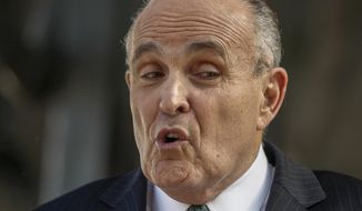 In this Oct. 16, 2014 file photo, lawyer and former New York City Mayor Rudy Giuliani calls for the dismissal of a lawsuit filed against video game giant Activision by former Panamanian dictator Manuel Noriega outside Los Angeles Superior court in Los Angeles. (AP Photo/Damian Dovarganes, File)