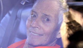 Millionaire Robert Durst is escorted from Orleans Parish Criminal District Court to the Orleans Parish Prison after his arraignment in New Orleans in this Tuesday, March 17, 2015, file photo. Durst is going back to court in New Orleans after nearly a week in a prison mental ward 70 miles away. (AP Photo/Gerald Herbert, File)