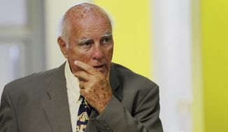 FILE - In this Monday, Feb. 9, 2015 file photo, former grand slam tennis doubles champion Bob Hewitt walks outside a court in Johannesburg, South Africa. A South African judge on Monday, March 23, 2015 convicted former Grand Slam doubles tennis champion Bob Hewitt of rape and sexual assault decades after the alleged assaults. (AP Photo, File)