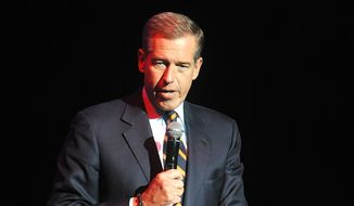 Brian Williams speaks at the 8th Annual Stand Up For Heroes, presented by New York Comedy Festival and The Bob Woodruff Foundation in New York, in this Nov. 5, 2014, file photo. Suspended NBC News anchor Williams and his wife attended a fundraiser, Saturday, March 21, 2015, and donated $50,000 in a bid to keep his Catholic high school in New Jersey, Mater Dei Prep, from closing. (Photo by Brad Barket/Invision/AP, File)