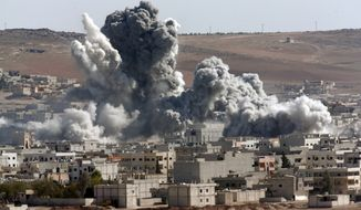 In this Oct. 22, 2014, file photo, thick smoke from an airstrike by the U.S.-led coalition rises in Kobani, Syria, as seen from a hilltop on the outskirts of Suruc, at the Turkey-Syria border. (AP Photo/Lefteris Pitarakis, File)