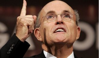Former New York Mayor Rudolph Giuliani gestures while speaking at the Riga Conference, on the sidelines of a NATO summit, in Riga, in this Nov. 28, 2006, file photo. (AP Photo/Virginia Mayo, File)