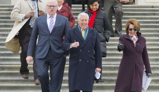 From right to left, House Minority Leader Nancy Pelosi of Calif., House Minority Whip Steny Hoyer of Md., Rep. Joseph Crowley, D-N.Y., House Assistant Minority Leader James Clyburn of S.C., and others, walk out together for an event on Capitol Hill in Washington, Tuesday, March 24, 2015, to commemorate the fifth anniversary of President Obama signing into law the Affordable Care Act. (AP Photo/Pablo Martinez Monsivais)