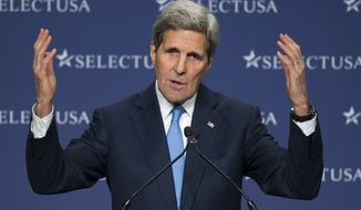 Secretary of State John Kerry gestures while speaking at the SelectUSA Investment Summit, hosted by the Commerce Department, Tuesday, March 24, 2015, in National Harbor, Md. (AP Photo/Cliff Owen)