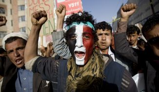 A Houthi Shiite rebel with Yemen's flag painted on his face chants slogans during a rally to show support for the leader of rebels, Abdel-Malik al-Houthi, in Sanaa, Yemen. (Associated Press)