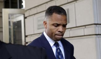 In this Aug. 14, 2013, file photo, former Illinois Rep. Jesse Jackson Jr., leaves federal court in Washington after being sentenced to 2 1/2 years in prison for misusing $750,000 in campaign funds. Jackson Jr. will be released from a federal prison on Thursday, March 26, 2015, and will serve out the remainder of his term in a Washington, D.C., halfway house, former U.S. Rep. Patrick Kennedy told The Associated Press after visiting Jackson behind bars. (AP Photo/Susan Walsh, File)