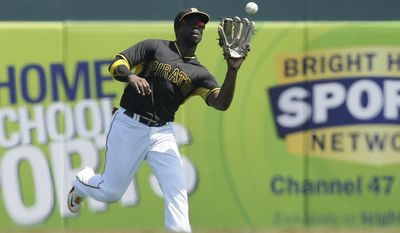 Pittsburgh Pirates center fielder Andrew McCutchen catches the flyout hit by Baltimore Orioles designated hitter Delmon Young during the first inning of a spring training exhibition baseball game in Bradenton, Fla., Tuesday, March 24, 2015. (AP Photo/Carlos Osorio)